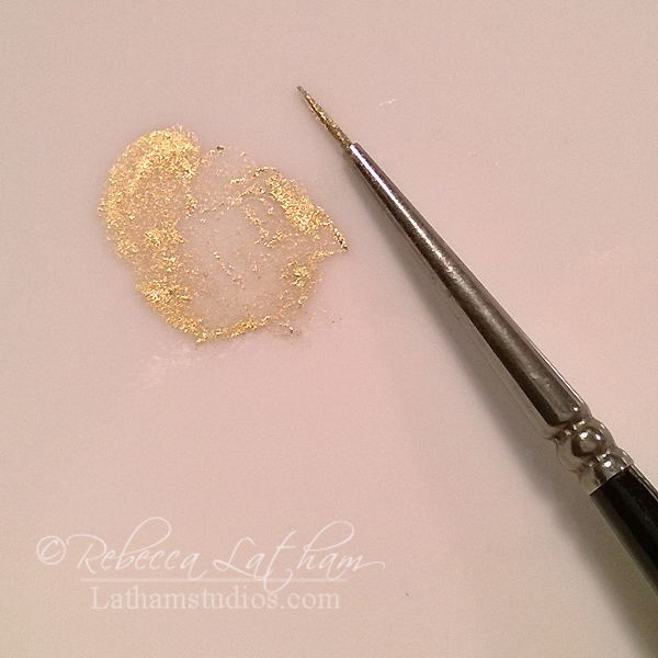 Gold with brush on palette thinned for use.